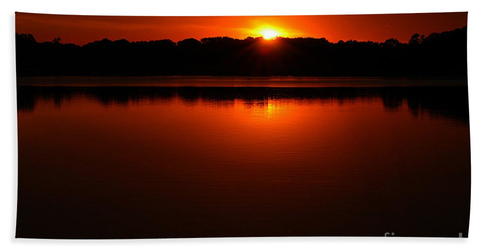 Clay Beach Towel featuring the photograph Burnt Orange Sunset On Water by Clayton Bruster