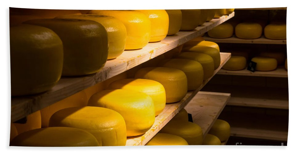 Netherlands Europe European Inside Travel Tourism Attraction Agriculture Holland Stacked Oval Round Manufacturing Storage Amsterdam Ripe Cheesemaking Edam Gouda Shelf Shelves Traditional Making Tradition Process Vegetarian Fresh Food Volendam Dutch Cheese Factory Aging Maturing Dairy Beach Towel featuring the photograph Cheese Factory by Marcin Rogozinski