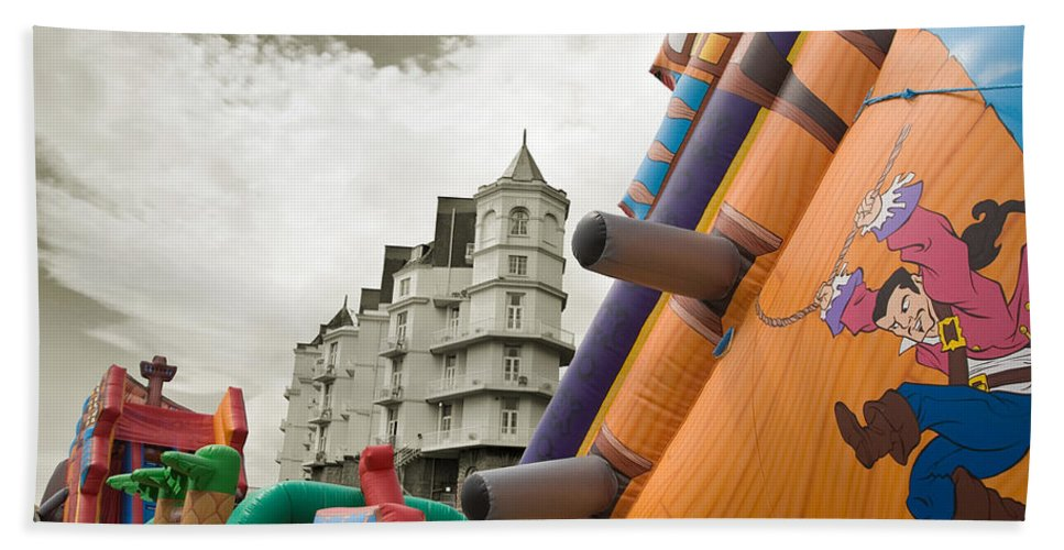Childrens Beach Sheet featuring the photograph Childrens Play Areas Contrast With The Victorian Elegance Of The Grand Hotel In Llandudno Wales Uk by Mal Bray