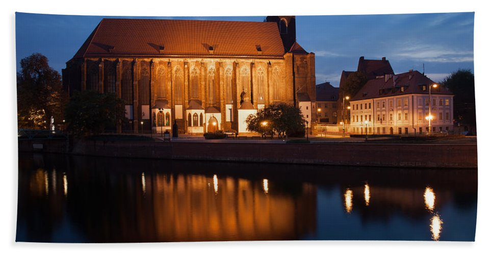 Wroclaw Beach Towel featuring the photograph Church Of Our Lady On Sand In Wroclaw By Night by Artur Bogacki