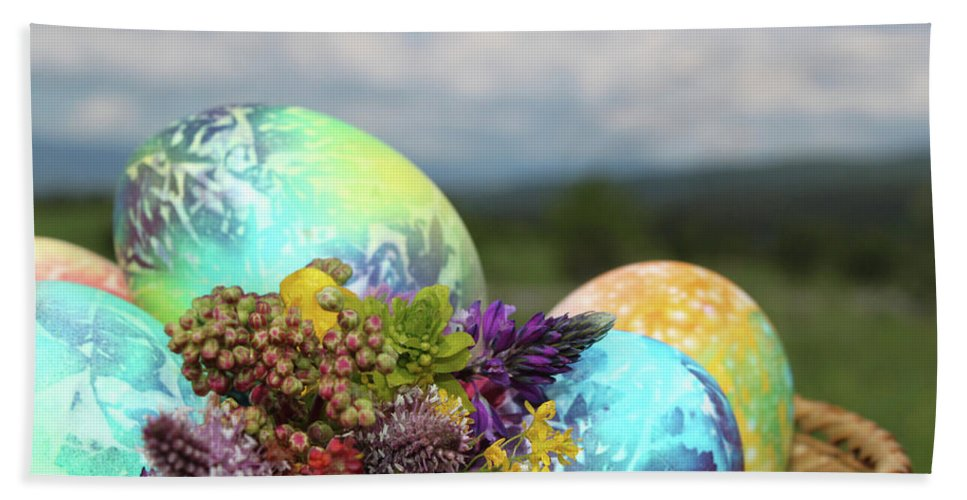 April Beach Towel featuring the photograph Colored Easter Eggs In Basket And Spring Flowers by Didart Collection