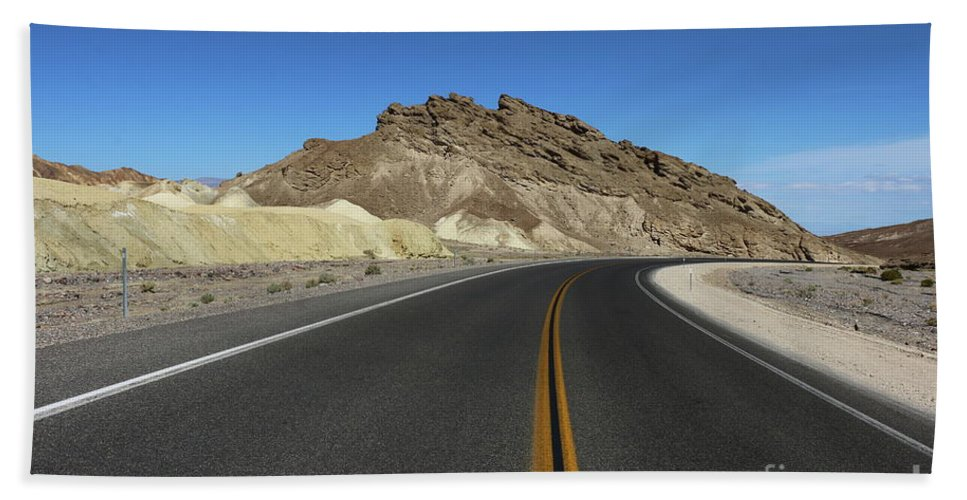 Badlands Beach Towel featuring the photograph Death Valley Road Through The Badlands by Christiane Schulze Art And Photography