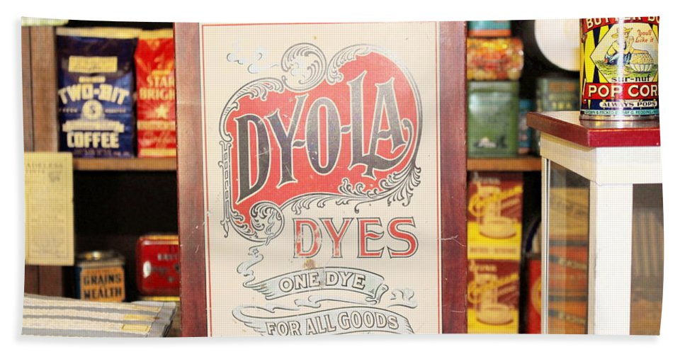 Ruddy's General Store Beach Towel featuring the photograph Dy-o-la Dyes by Colleen Cornelius