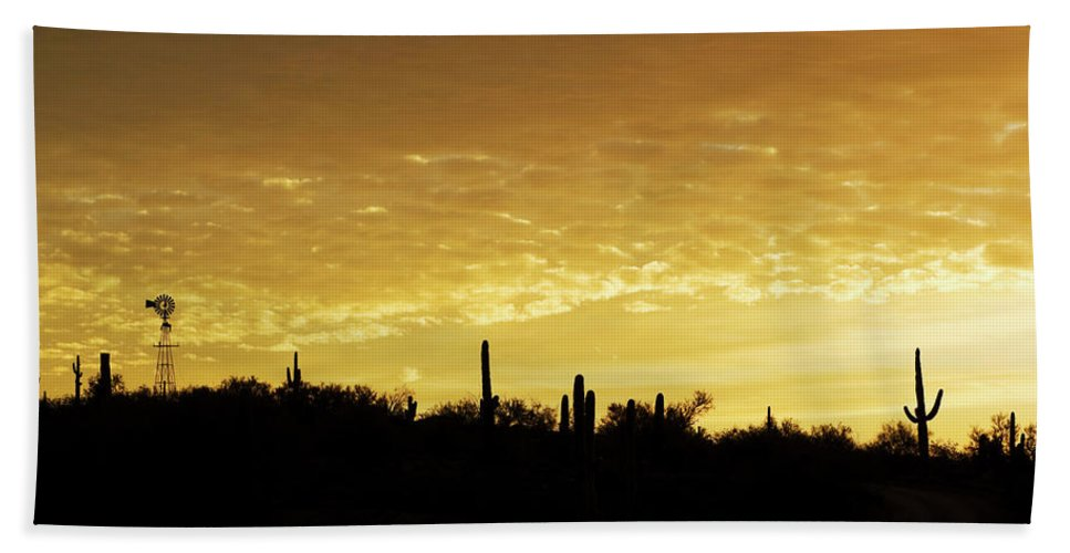 Sunrise Beach Towel featuring the photograph Golden Sunrise by Phyllis Denton