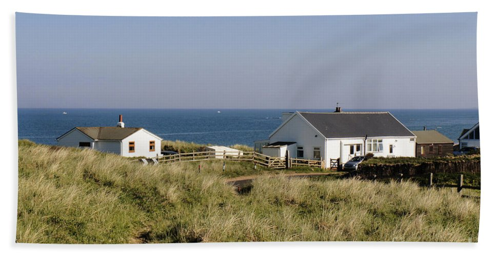 Coast Beach Towel featuring the photograph Houses In Low Hauxley. by Elena Perelman