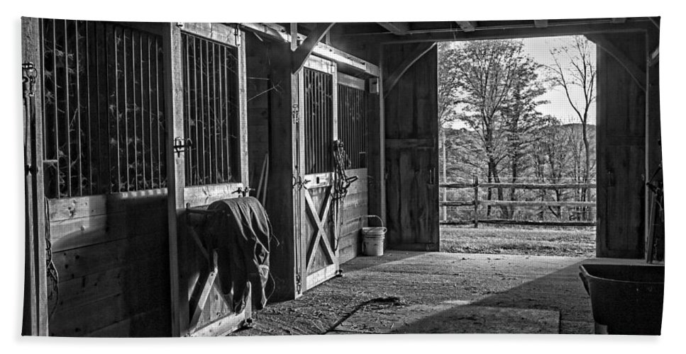 White beach towel featuring the photograph inside the horse barn black and white by edward fielding