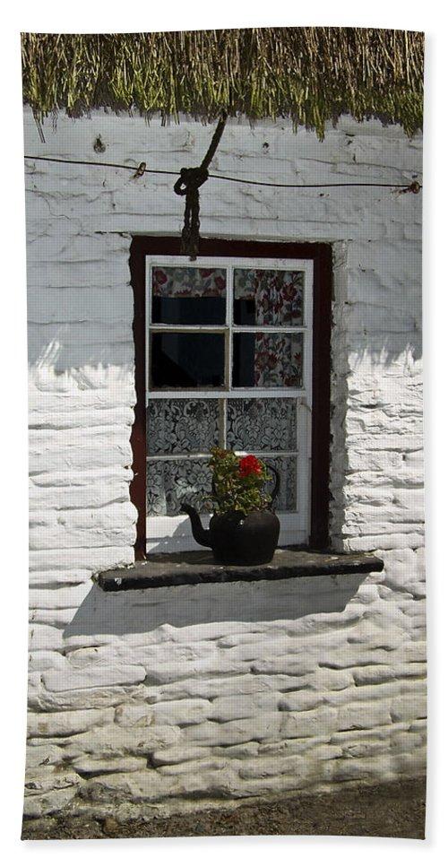 Irish Beach Towel featuring the photograph Irish Kettle Of Geraniums County Cork Ireland by Teresa Mucha