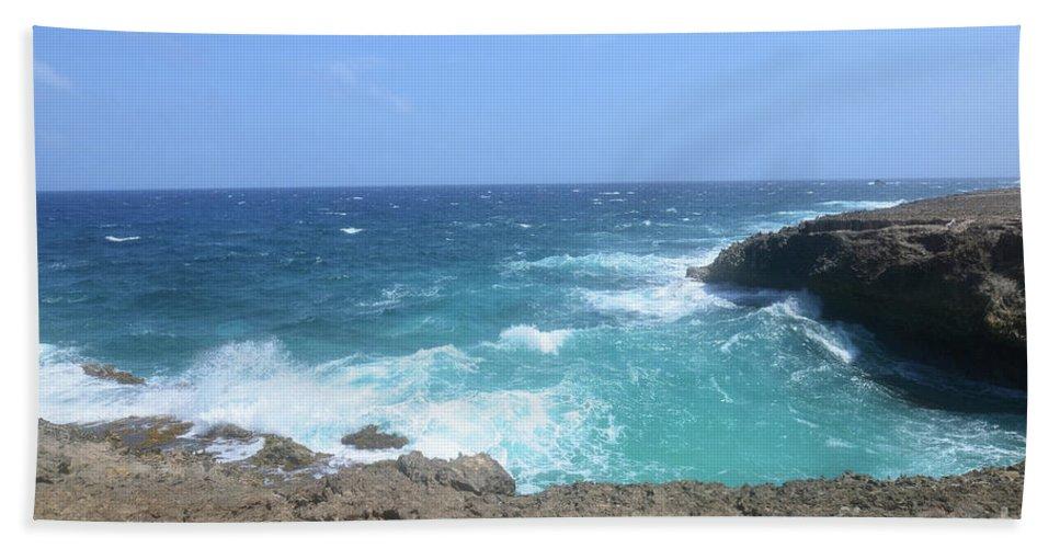Daimari Beach Towel featuring the photograph Lava Rock Cliffs And Crashing Ocean Waves In Aruba by DejaVu Designs