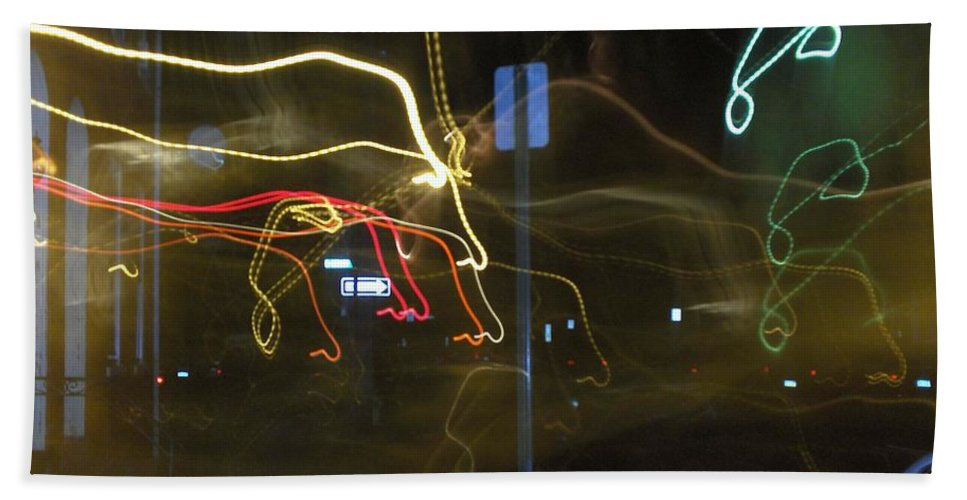 Photograph Beach Towel featuring the photograph Lights That Attack Cars Two by Thomas Valentine