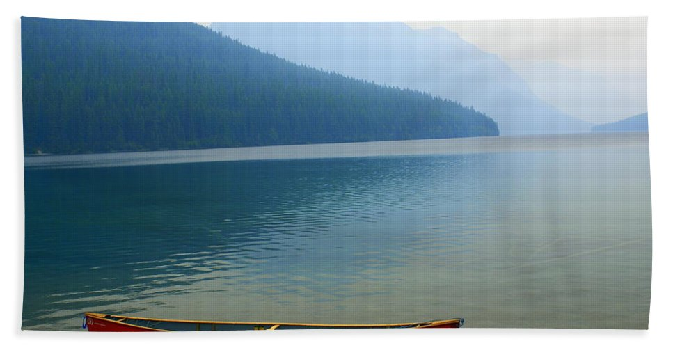 Glacier National Park Beach Towel featuring the photograph Lonly Canoe by Marty Koch