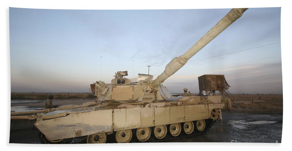 Camp Warhorse Beach Towel featuring the photograph M1 Abrams Tank At Camp Warhorse by Terry Moore