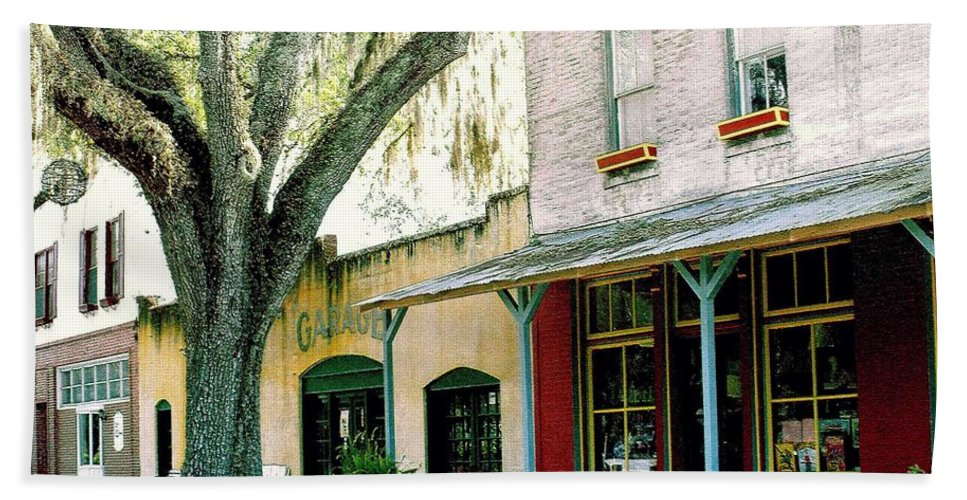 Micanopy Beach Towel featuring the photograph Micanopy Storefronts by Nelson Strong