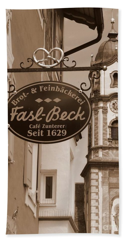 Mittenwald Beach Towel featuring the photograph Mittenwald Cafe Sign In Sepia by Carol Groenen