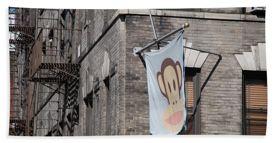 Street Scene Beach Towel featuring the photograph Monkey Flag by Rob Hans