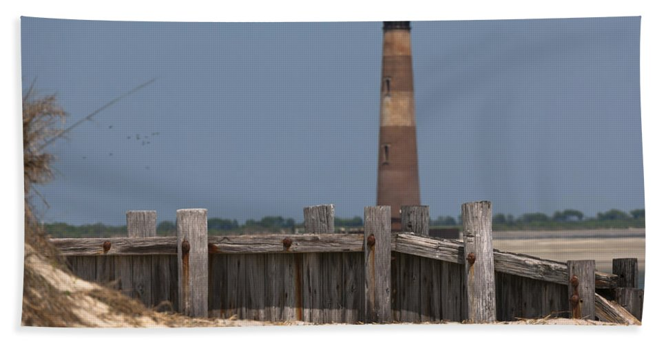 Morris Island Lighthouse Beach Towel featuring the photograph Morris Island Lighthouse Sea Wall by Dale Powell
