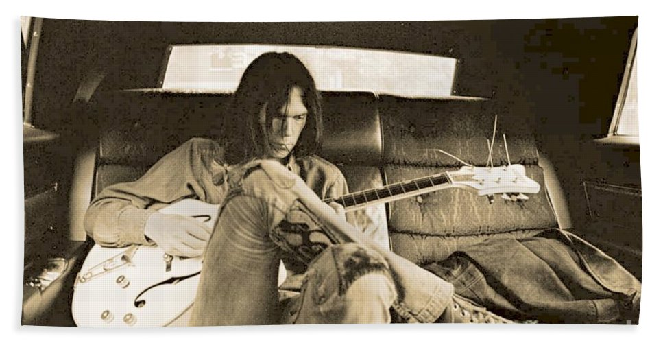 Neil Young In The Backseat Beach Towel featuring the photograph Neil Young in the Backseat by John Malone