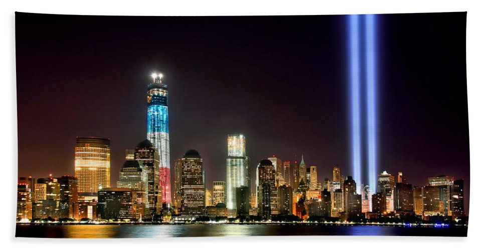 New York City Skyline At Night Beach Towel featuring the photograph New York City Skyline Tribute In Lights And Lower Manhattan At Night Nyc by Jon Holiday
