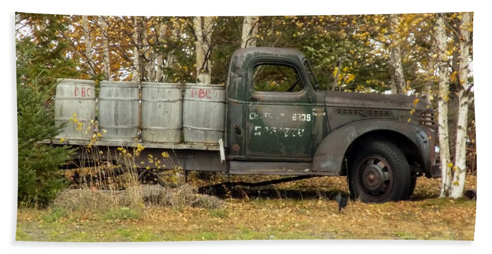 Potato Barrels Beach Towel featuring the photograph Old Truck With Potato Barrels by William Tasker