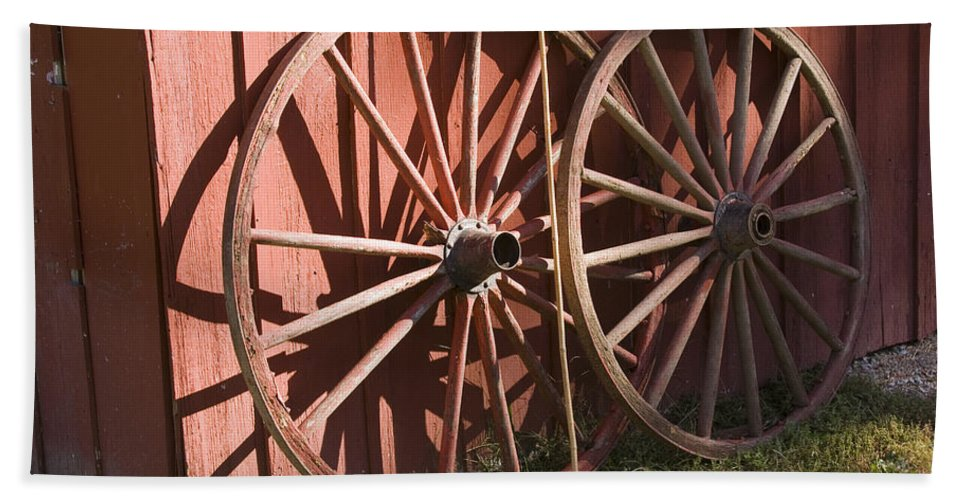 Old Time Antique Wagon Wheel Wood Wooden Red Barn Rural Country Farm Farming Round Beach Towel featuring the photograph Old Wagon Wheels by Andrei Shliakhau