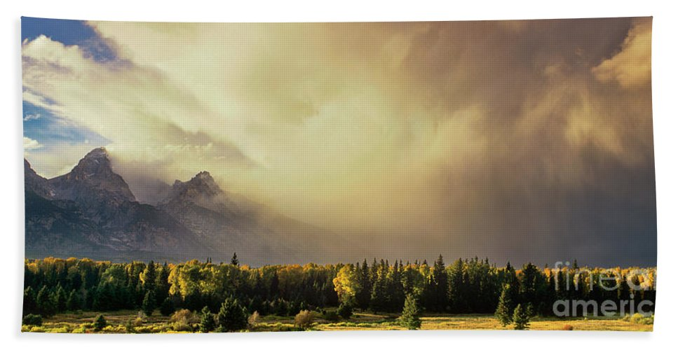 North America Beach Towel featuring the photograph Panorama Clearing Storm Over The Grand Tetons by Dave Welling
