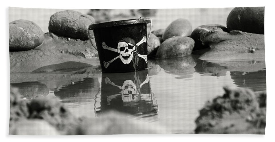 Bucket Pirate Sand Sandy Beach Jolly Roger Skull & Crossbones Pebbles Sea Seaside Water Wet Reflection Black & White Handle Sidmouth Fun Castle Digging Playing Beach Towel featuring the photograph Pirtate Bucket by Matthew Bates