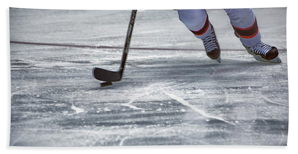 Hockey Beach Towel featuring the photograph Player And Puck by Karol Livote