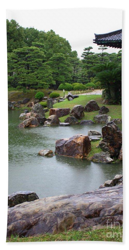 Rain Beach Towel featuring the photograph Rainy Japanese Garden Pond by Carol Groenen