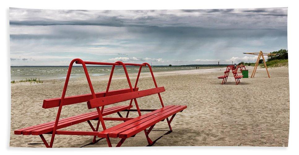 Baltic Sea Beach Towel featuring the photograph Red Bench On A Beach by Jukka Heinovirta