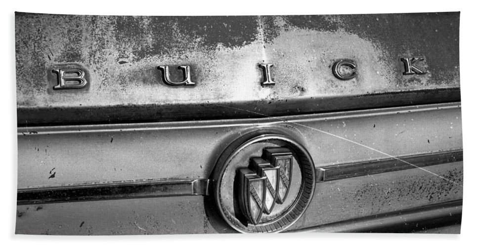 Buick Hood Emblem Beach Towel featuring the photograph Rusty Buick Emblem Black And White by Nick Gray