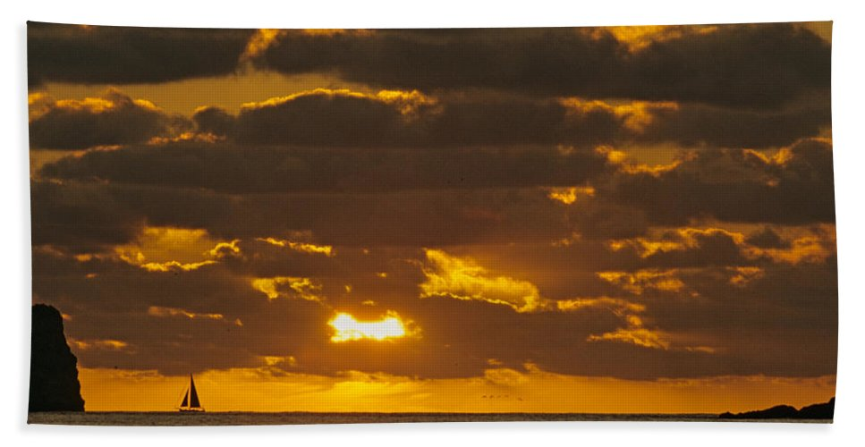 Sil Beach Towel featuring the photograph Sailboat As The Sun Sets by John Harmon