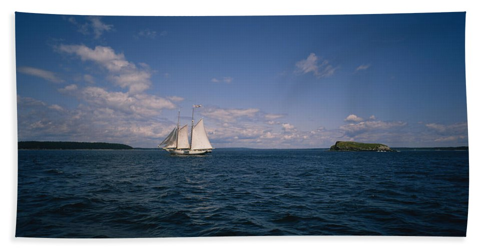 Photography Beach Towel featuring the photograph Sailboat In The Sea, St. Maarten by Panoramic Images