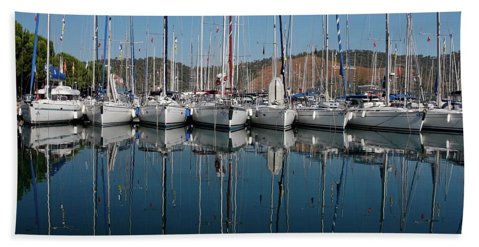 Sailboats Docked Close Together Beach Towel featuring the photograph Sailboats Reflected by Sally Weigand