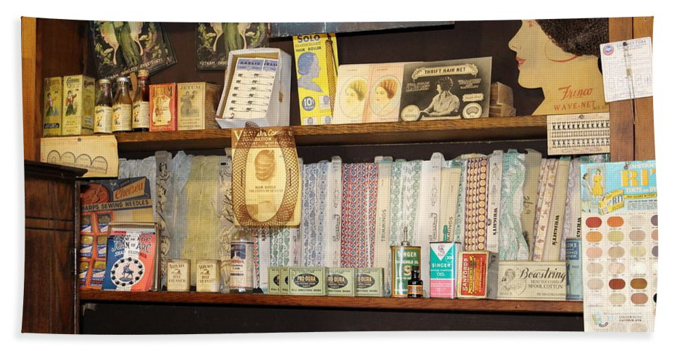 Ruddy's General Store Beach Towel featuring the photograph Sewing Moments by Colleen Cornelius