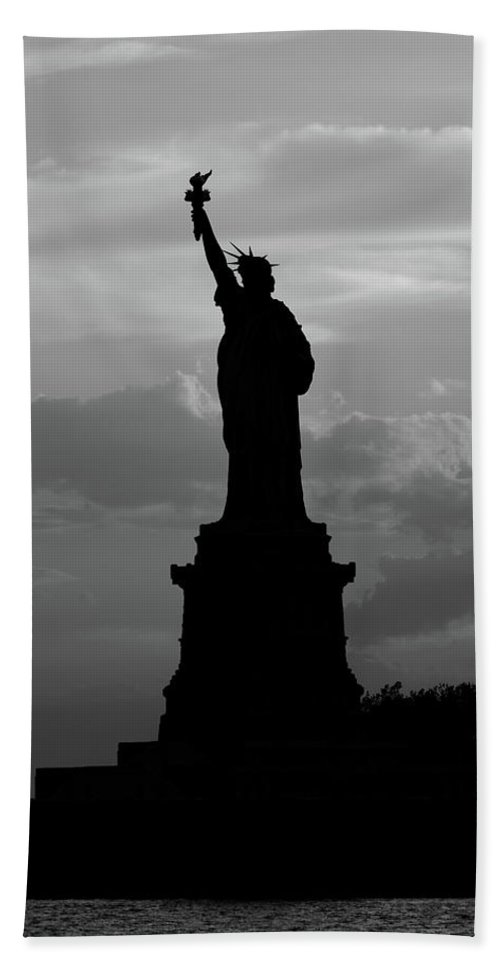 06/2016 Beach Towel featuring the photograph Statue Of Liberty, Silhouette by Marco Catini