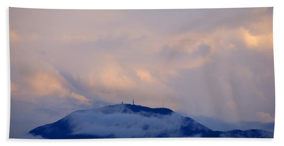 Storm Beach Towel featuring the photograph Storm Clouds Gather Over Mountains by Ian Middleton
