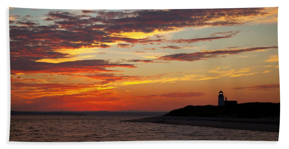 Sunset Beach Towel featuring the photograph Sunset Over Sandy Neck Lighthouse by Charles Harden