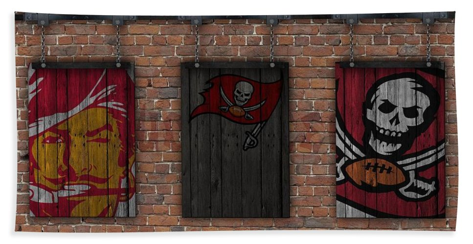 Tampa Bay Buccaneers Beach Towel featuring the photograph Tampa Bay Buccaneers Brick Wall by Joe Hamilton