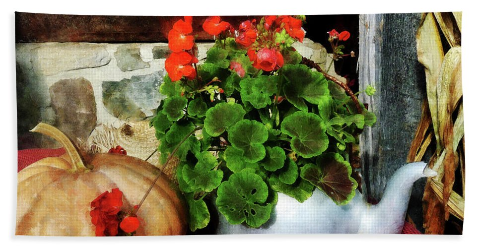 Autumn Beach Towel featuring the photograph Teapot Filled With Geraniums by Susan Savad