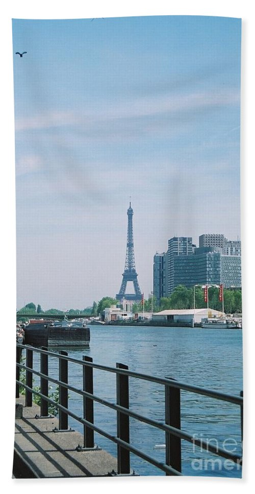 The Eiffel Tower Beach Towel featuring the photograph The Eiffel Tower And The Seine River by Nadine Rippelmeyer