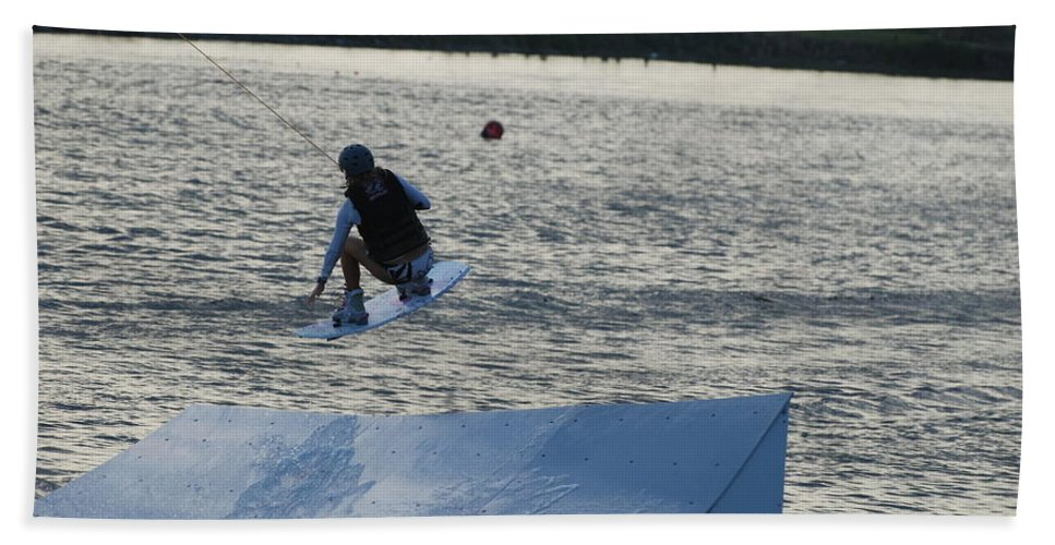 Water Beach Towel featuring the photograph The Jump by Rob Hans