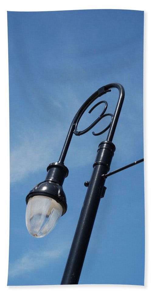 Blue Sky Beach Towel featuring the photograph The Lamp Post by Rob Hans