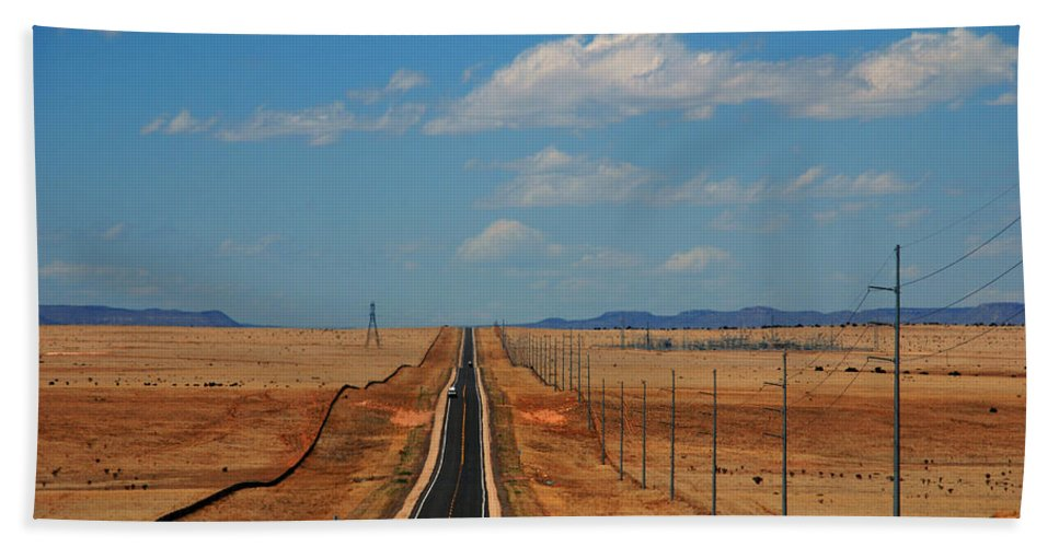 Long Road Beach Towel featuring the photograph The Long Road To Santa Fe by Susanne Van Hulst