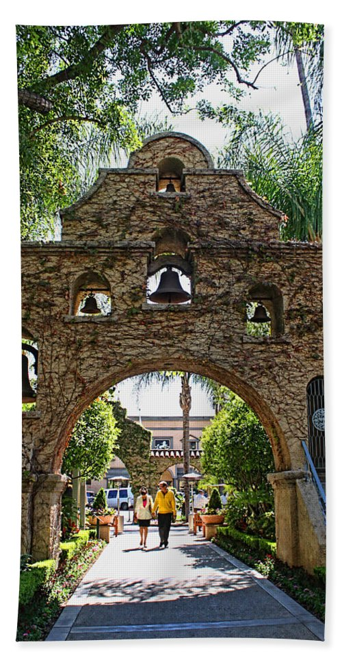 Mission Inn Beach Towel featuring the photograph The Mission Inn Entrance by Tommy Anderson