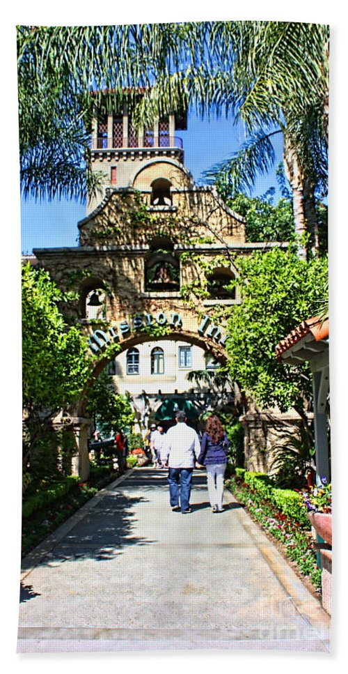 Mission Inn Beach Towel featuring the photograph The Mission Inn Stage Coach Entrance by Tommy Anderson