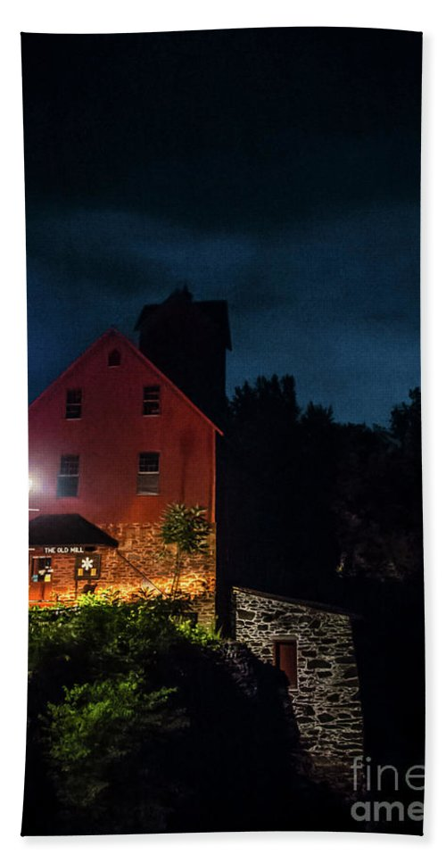 Red Mill Beach Towel featuring the photograph The Old Red Mill At Night by James Aiken