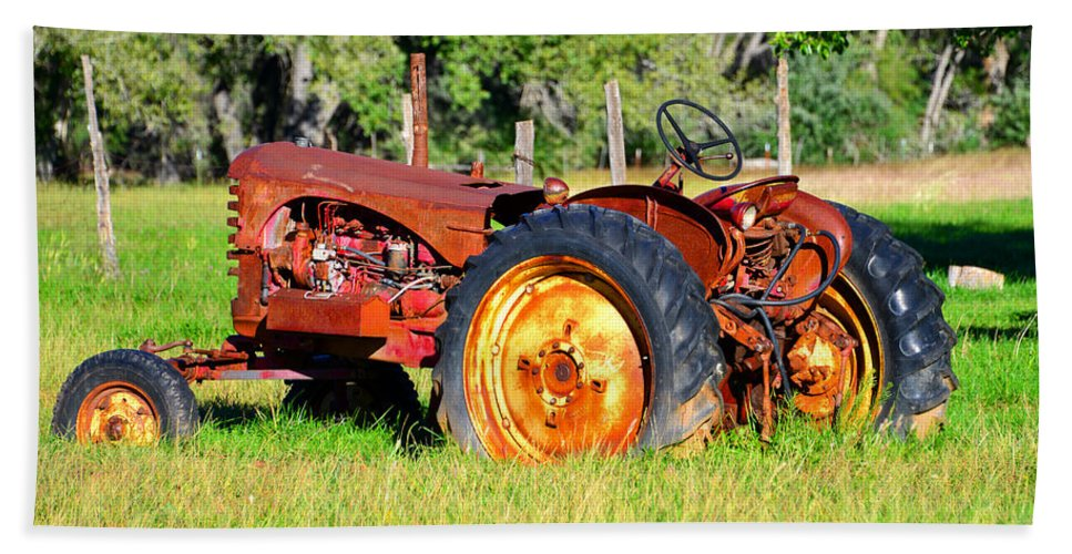 Old Tractor In The Field Beach Towel featuring the photograph The Old Tractor In The Field by David Lee Thompson