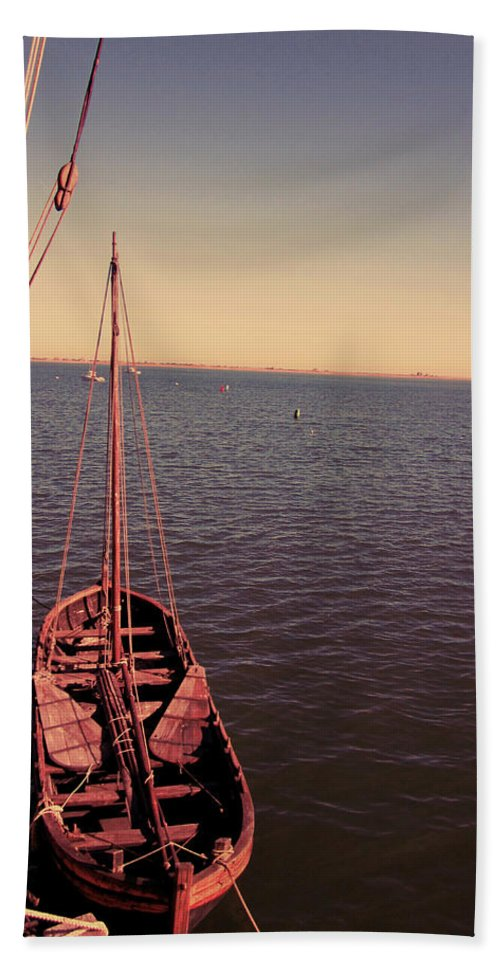 Wooden Boat Photographs Beach Towel featuring the photograph The Old Wooden Boat by Lourry Legarde