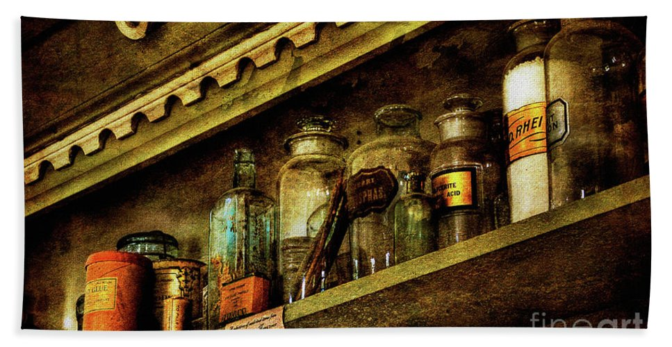 Glass Bottles Beach Towel featuring the photograph The Olde Apothecary Shop by Lois Bryan
