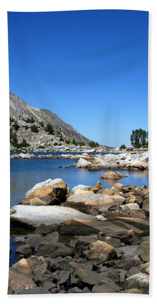 The Rocks Of Treasure Lakes Beach Towel featuring the photograph The Rocks Of Treasure Lake by Chris Brannen