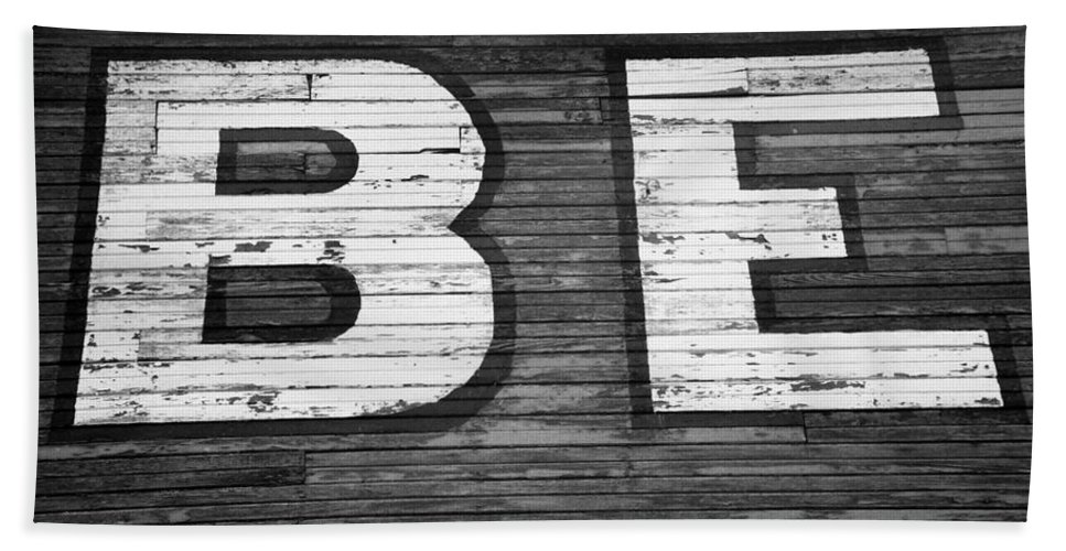 Paint Beach Towel featuring the photograph The Word Be Painted On The Side Of Old Building by John Harmon